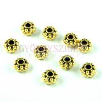 Fémgyöngy - arany színű - 6.5x4.5mm