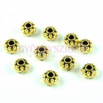 Fémgyöngy - arany színű - 6.5x4.5mm - 50db - AKCIÓS