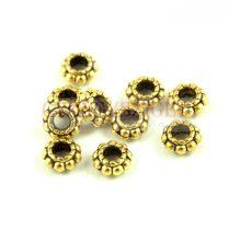 Fémgyöngy - arany színű - 6mm