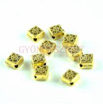 Fémgyöngy - átlósan fúrt - arany színű - 4.5x4.5mm