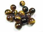 Tigereye beads and cabochons